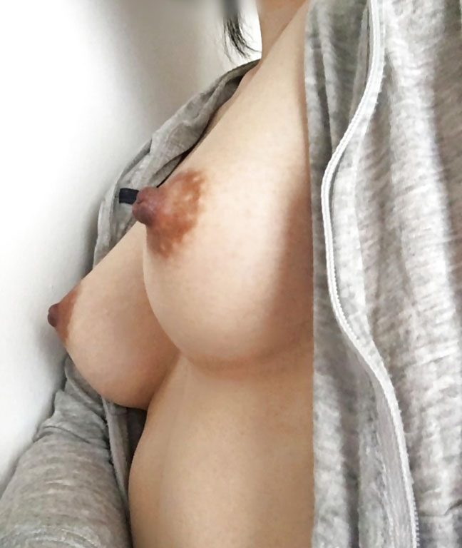 Chinese girl shows her hard nipples