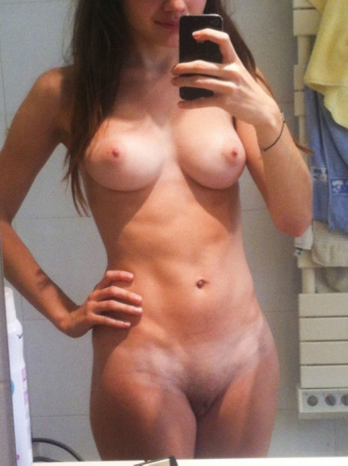 Naked girls with phone in front of a mirror