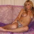 Cute blonde girlfriend naked in bedroom