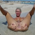 Nude shaved blonde at the beach
