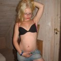 A blond amateur girl pose