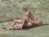 Thumb for Nudist blonde girl rides on cock on public beach