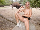 Sexy blonde girl in Zoo